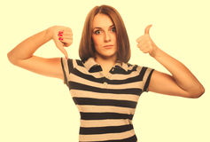 Girl woman shows signs yes and no, hand fingers isolated on whit Stock Image
