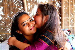 Girl and woman smiling. Girl kissing to women and kidding Royalty Free Stock Photography