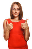 Girl woman young positive sign thumbs yes in red Royalty Free Stock Photography