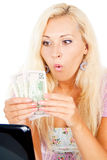 Girl wonders money Royalty Free Stock Photo