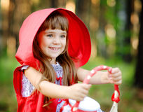 Girl in the wood with a basket in hands. Stock Images