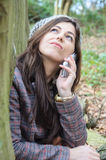 Girl in the wood. A Pretty girl in the woods walking and using her mobile phone Royalty Free Stock Images