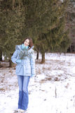 Girl in a wood in the winter Stock Images