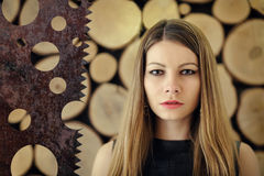 Girl on a wooden background Stock Image