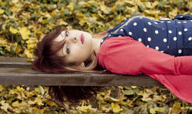 Girl on wooden bench Stock Image