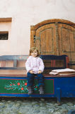 Girl on Wooden Bench Stock Photography