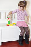 Girl and wooden blocks Royalty Free Stock Images