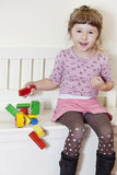 Girl and wooden blocks Stock Photography