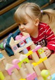 Girl with wooden blocks royalty free stock images