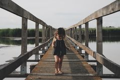 Girl on wooden bridge