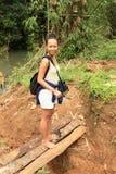 Girl on wooden bridge stock images