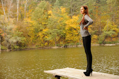 Girl on the wooden bridges. On  pond Royalty Free Stock Photos