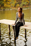 Girl on the wooden bridges. On  pond Stock Photo
