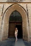 Girl wooden door Gothic Church stock photo