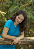 Girl on Wooden Fence Stock Photography