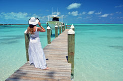 Girl on the wooden jetty Royalty Free Stock Photos