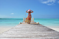 Girl on the wooden jetty. Exuma, Bahamas Royalty Free Stock Photos