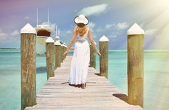 Girl on the wooden jetty Stock Images