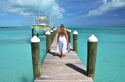 Girl on the wooden jetty Stock Photos