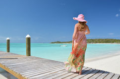 Girl at the wooden jetty royalty free stock image