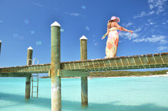 Girl on the wooden jetty making soap bubbles Royalty Free Stock Photos