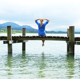 Girl on the wooden jetty Royalty Free Stock Images
