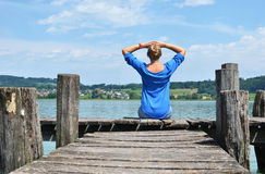 Girl on the wooden jetty Royalty Free Stock Image