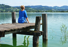 Girl on the wooden jetty Royalty Free Stock Photo