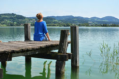 Girl on the wooden jetty Royalty Free Stock Photography