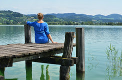Girl on the wooden jetty Stock Photography