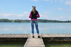 Girl on the wooden jetty Stock Photo