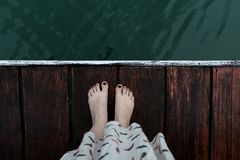 girl on a wooden pier royalty free stock images