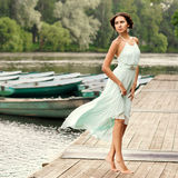 Girl at wooden pier Royalty Free Stock Image