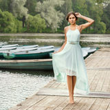 Girl at wooden pier Royalty Free Stock Images