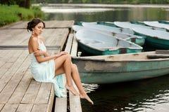 Girl at wooden pier Stock Photos