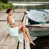 Girl at wooden pier Royalty Free Stock Photography
