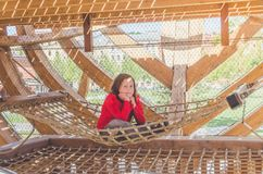 Girl on a wooden Playground in the form of a pirate ship. A child, a girl on a wooden Playground in the form of a pirate ship stock images