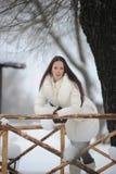 Girl on a wooden rail bridge Royalty Free Stock Photography