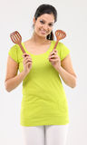 Girl with wooden sticks used in kitchen Stock Photo