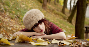 Girl on wooden table Royalty Free Stock Photos