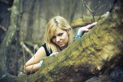 Girl in the woods Royalty Free Stock Photography