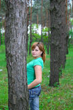 The girl in the woods. Against the backdrop of trees, the girl in the lap of nature Royalty Free Stock Photo