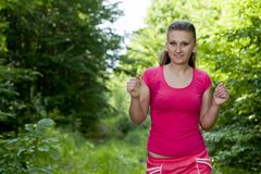 Girl in the woods. Beautiful, young girl jogging in the woods Royalty Free Stock Images