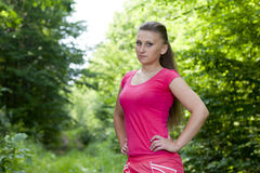 Girl in the woods. Beautiful young girl jogging in the woods Royalty Free Stock Images
