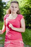 Girl in the woods. Beautiful, young girl jogging in the woods Stock Photos
