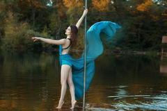 Girl in the woods a lake dancing dance. Stock Photography