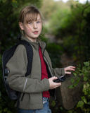 Girl in the woods navigating Stock Photo