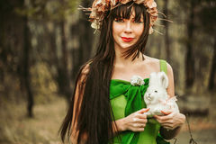 The girl in the woods with a toy. In the hands of Royalty Free Stock Images