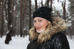 The girl in the woods. Girl in the winter forest Stock Photo