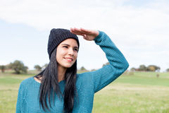 Girl with wool cap in the field Royalty Free Stock Image